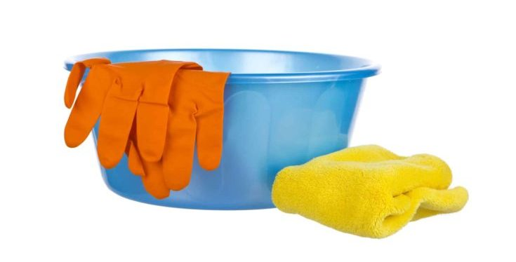 Blue wash-basin with rubber gloves and towel